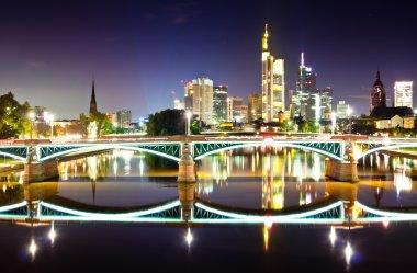 Frankfurt skyline reflection in the river of Main