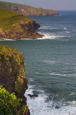 A view from the coastal path leading into Port Isaac in Cornwall