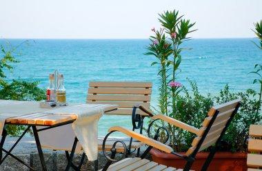 Restaurant table near the sea shore of the Black Sea, Bulgaria stock vector