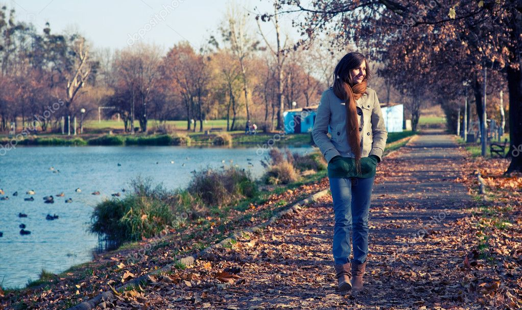 Young slim woman walking in the park