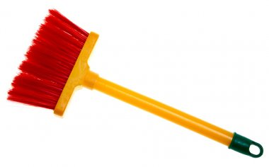 Children's toy plastic broom isolated on white background.