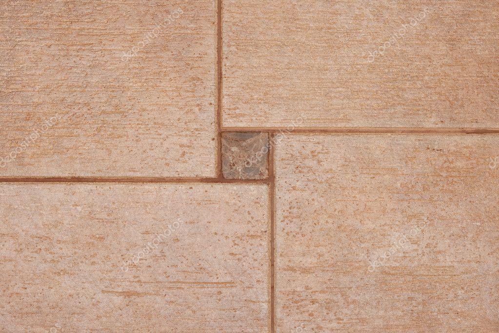 La texture delle piastrelle di ceramica marrone può essere