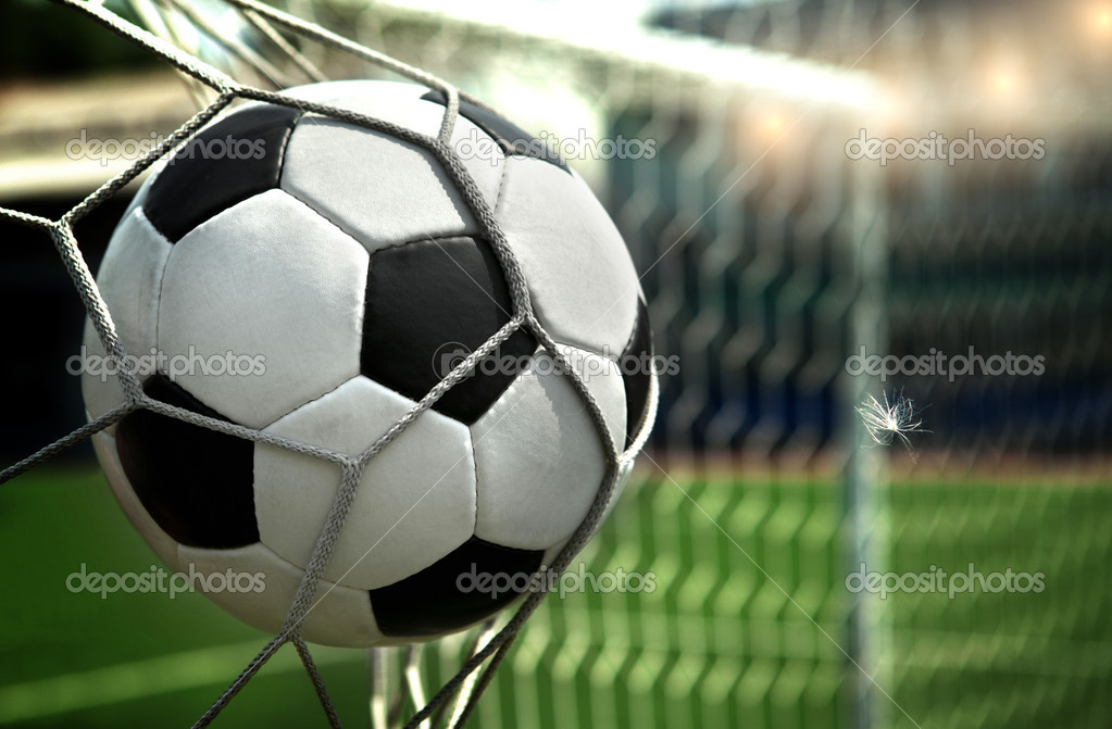 Football. The ball flies into the net gate