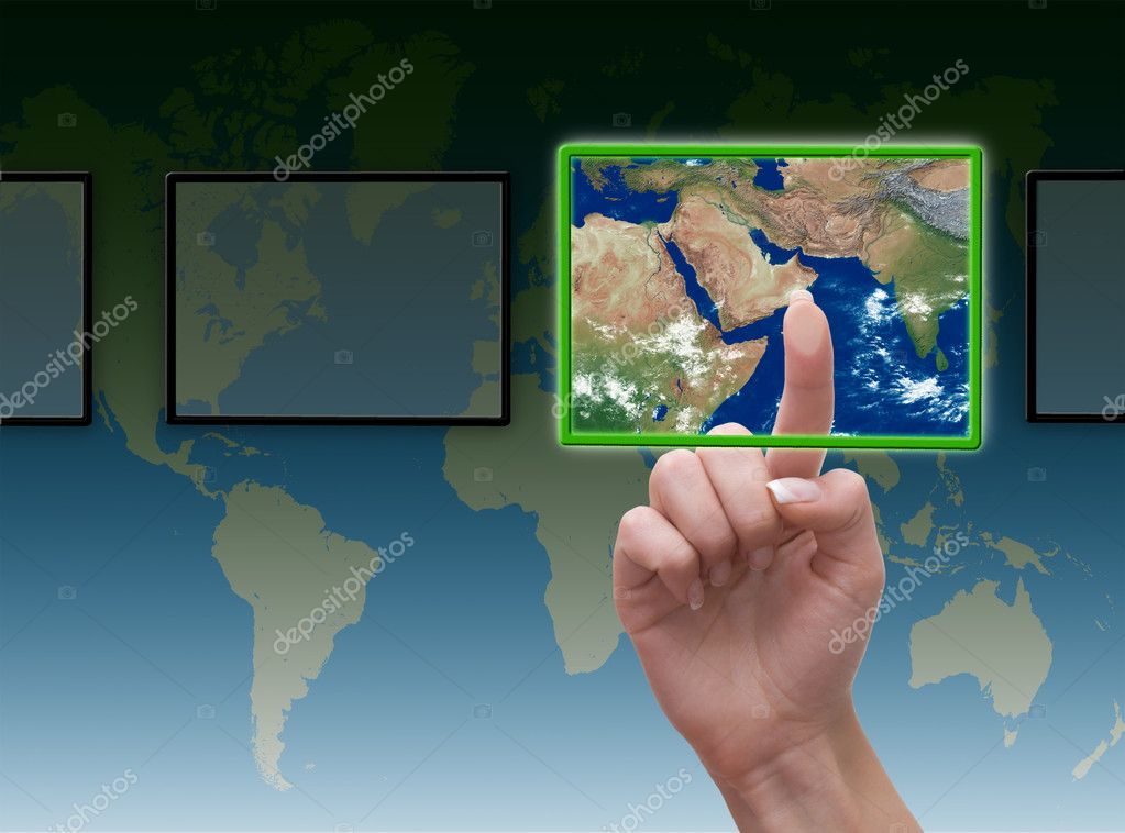 Hand pressing touchscreen button on the world background