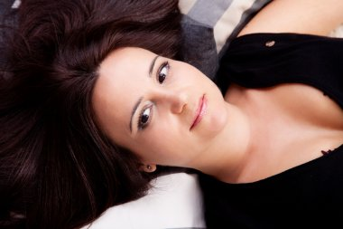 Beautiful and smiling middle-age woman lying