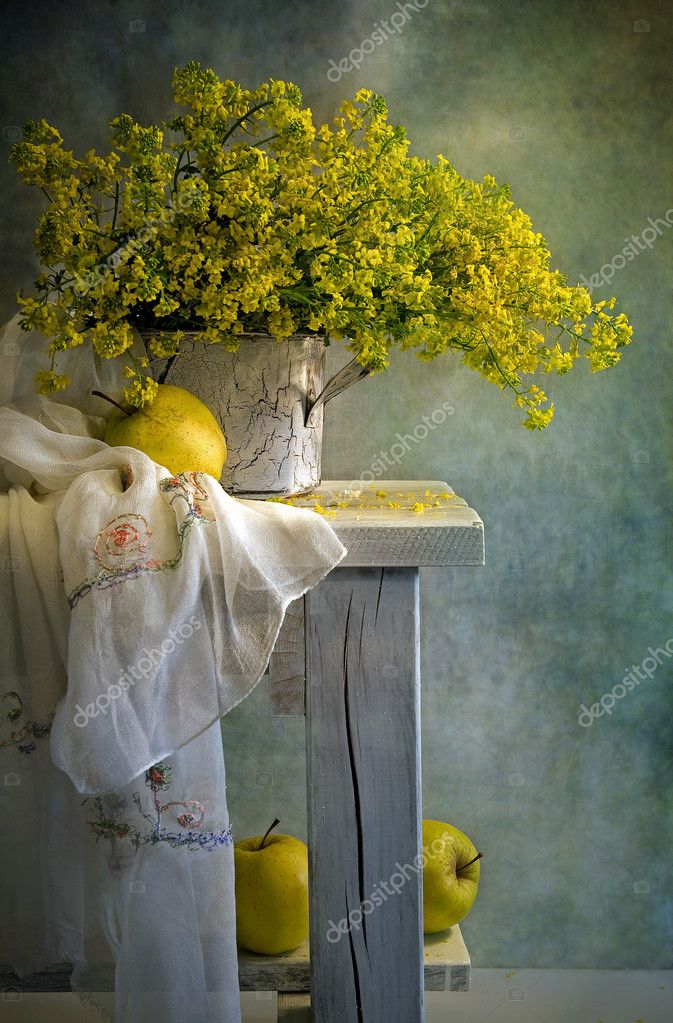 Still life with apples and yellow flowers