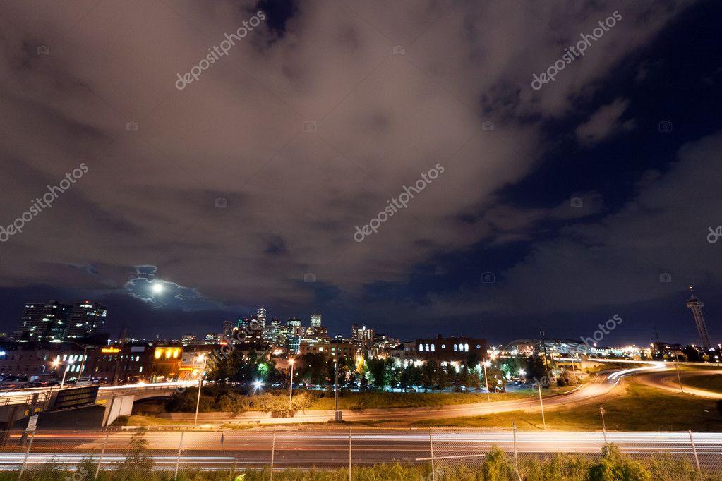 Moon Rising Above The Denver Colorado Skyline