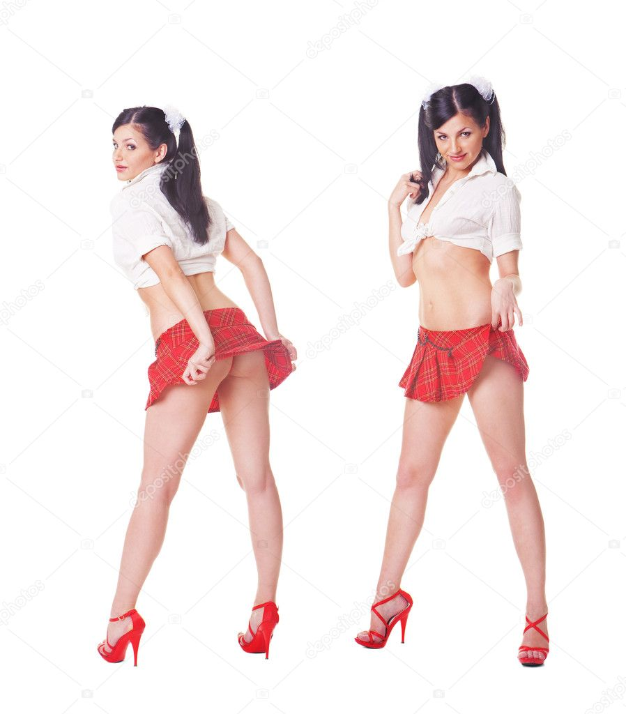 Two cute sexy schoolgirls playing with skirt, full length isolat