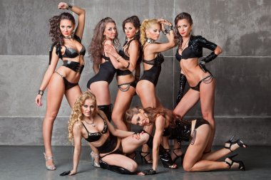 Seven Cute go-go sexy girls in black with diamonds costume