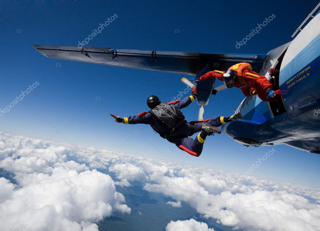 Two skydivers jumping from airplane