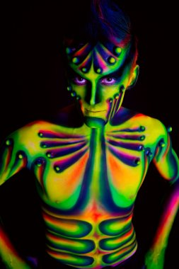 Man with fluorescent bodyart