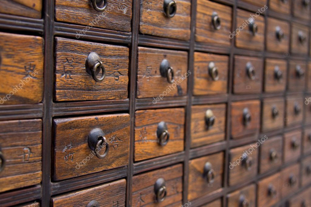 An antique chest used to store chinese medicinal herbs — Photo by Kacpura - Antique Chinese Medicine Chest — Stock Photo © Kacpura #9362636