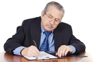 Seniors man writing