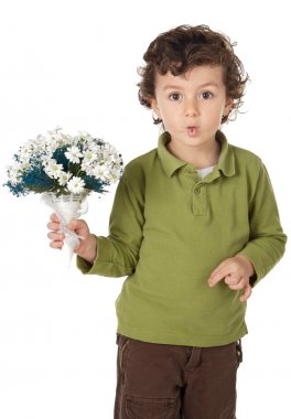Adorable boy with flowers and making trivialities