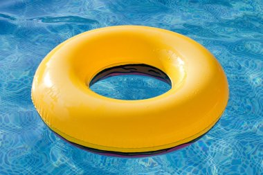 Yellow float floating in the pool with blue water stock vector