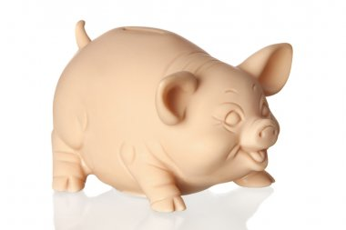 Piggy bank with reflection on the floor