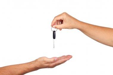Hand giving car keys