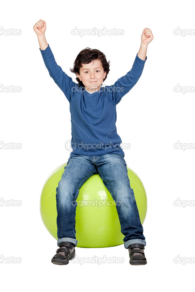 Child sitting on a pilates ball isolated on a over white background