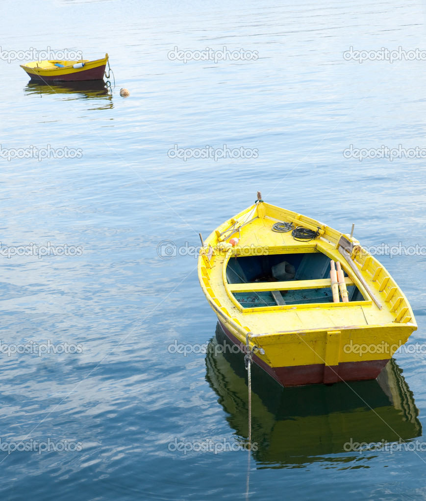 Two yellow rowing boats