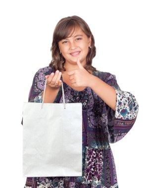 Adorable preteen girl shopping saying OK
