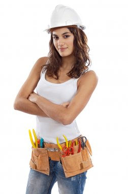 Pretty girl with helmet and belt of tools