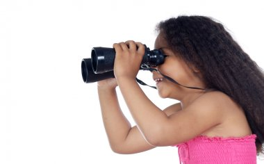 Girl looking through the binoculars
