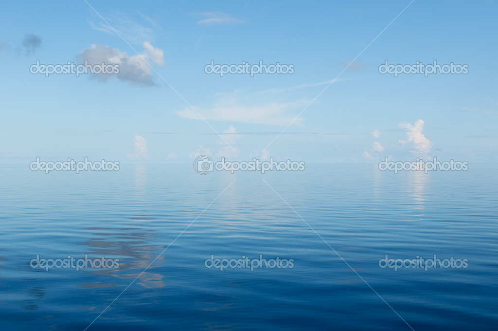 Background of ocean and blue cloudy sky