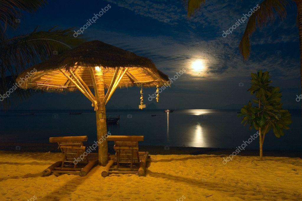 Beach Chairs At Tropical Resort Night Scene Stock Photo