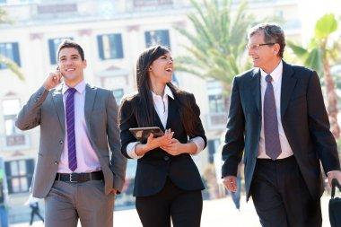 Business team meeting outdoors.