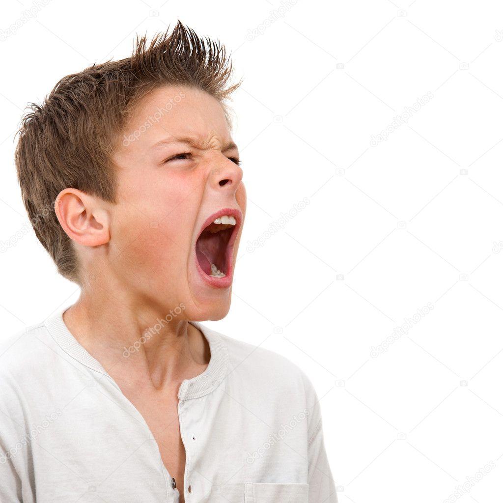 Close up portrait of boy shouting