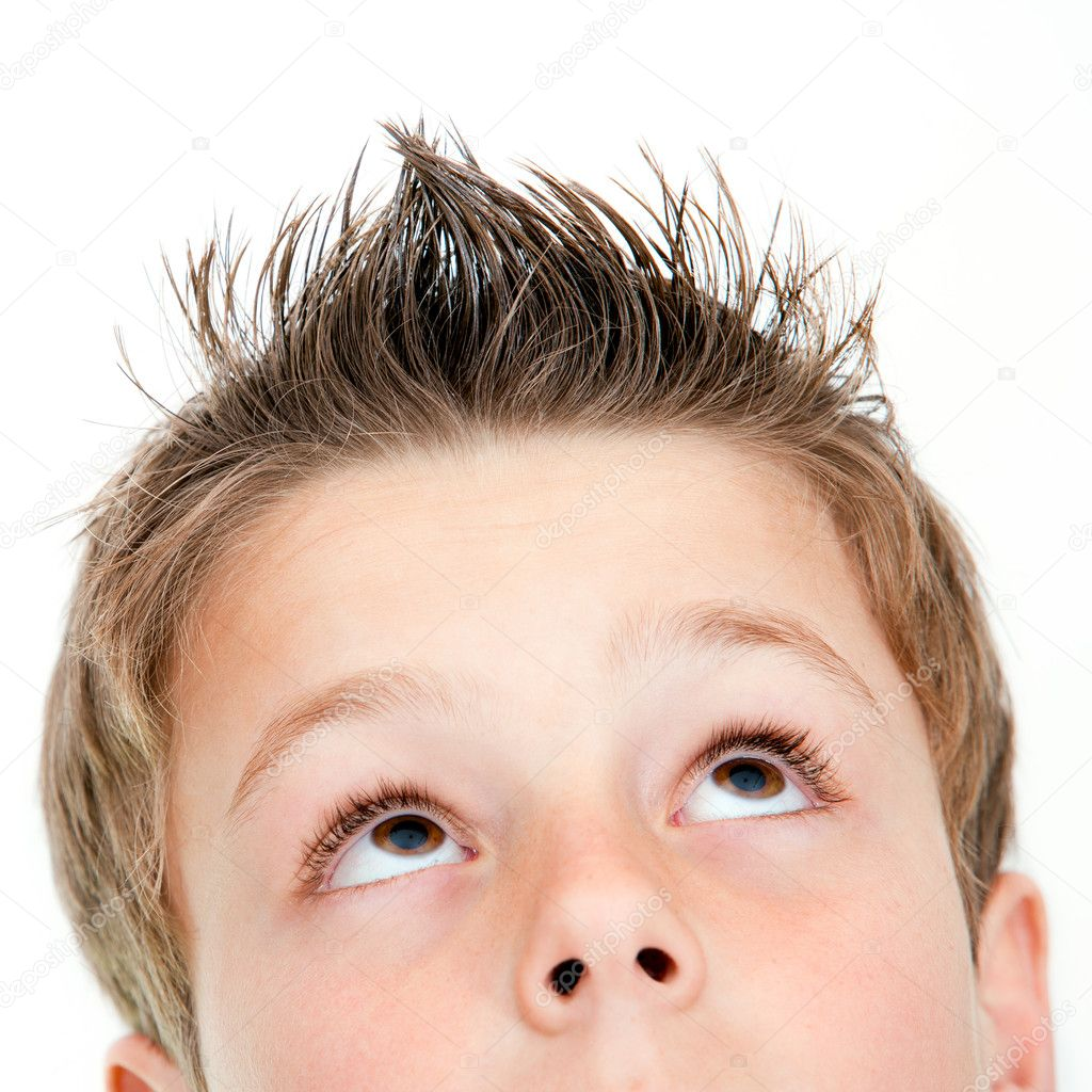 Extreme close up of boy looking up.