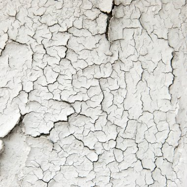 Old cracked paint on the concrete wall