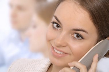 Closeup of a smiling young business executive