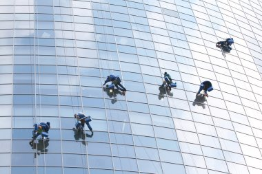 Six workers on office building