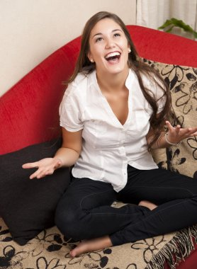 Happy young woman at home