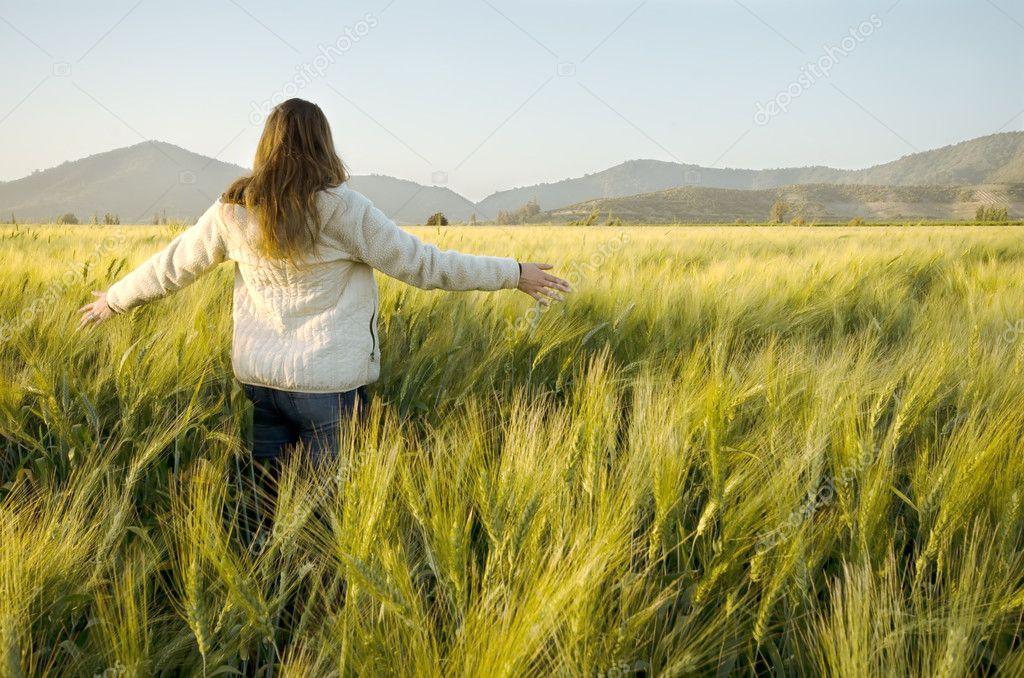 Woman in a cornfield