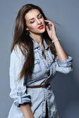 Photo Studio portrait of the pretty young girl wearing denim shirt