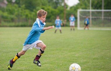 Little Boy playing soccer