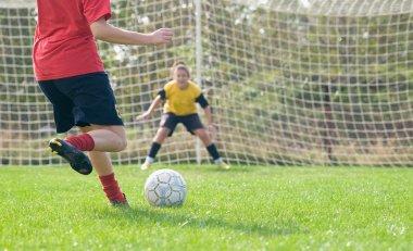 Women kicking ball