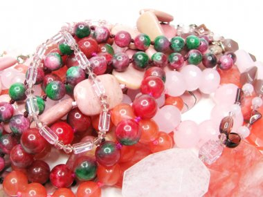 Heap of red and pink beads