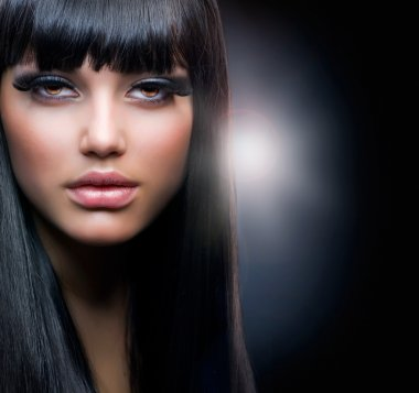 Fashion Brunette.Beautiful Makeup and Healthy Black Hair