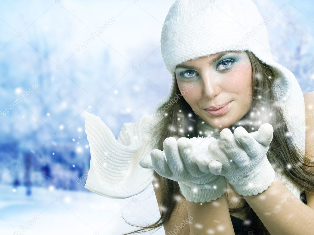 Christmas Girl. Winter Girl Blowing Snow