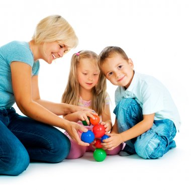 Children playing on the floor. Educational games for kids