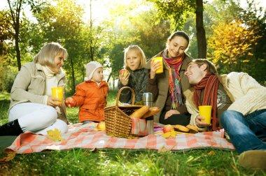 Happy Big Family in Autumn Park. Picnic