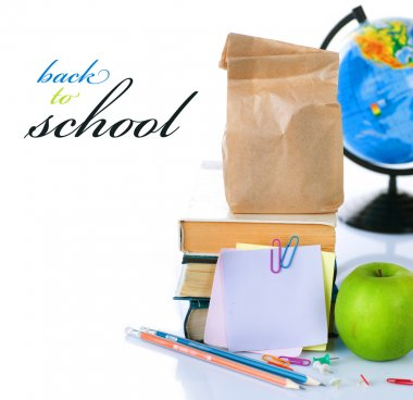Back To School Concept. School Books And Green Apple Isolated On