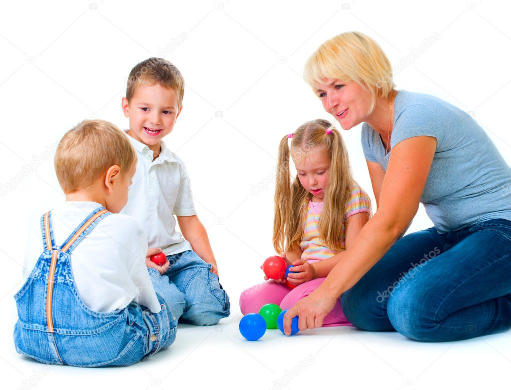 Children playing on the floor with teacher happy kids for On the floor