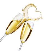 zwei Champagner-Gläser mit abstract splash