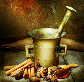 Fotografie Spices And Antique Mortar With Pestle