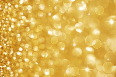 Christmas Golden Glittering background.Holiday Gold abstract tex