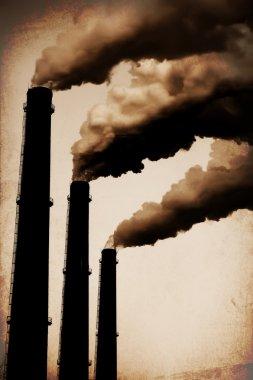 Three Smoke Stacks Polluting the Air Horizontal. Vintage Styled
